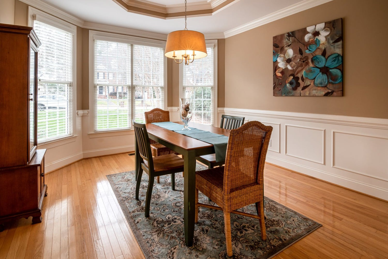 rug placement for dining room. Rug, brown wooden table with chairs