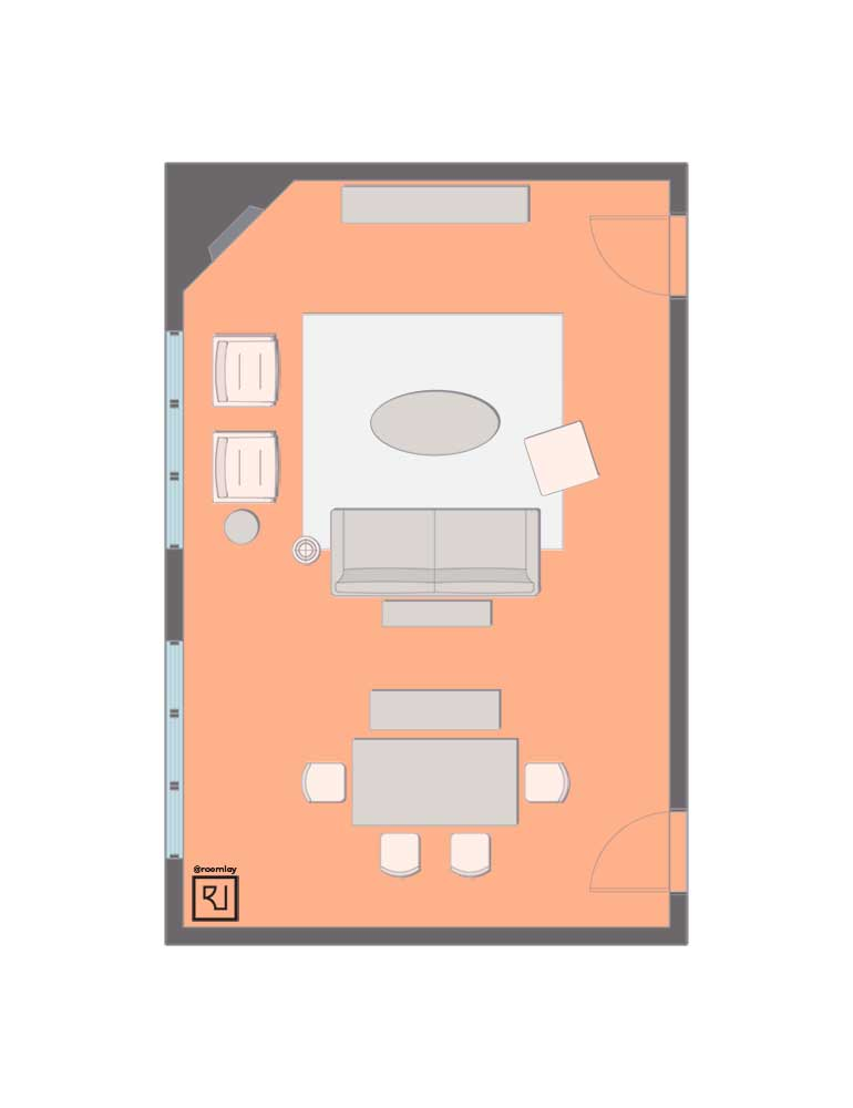 Combined living room dining room layout with corner fireplace.