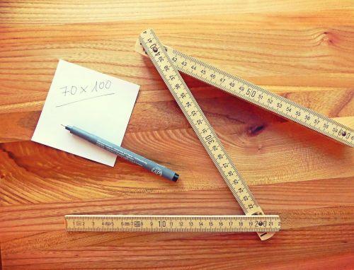 folded ruler and pen