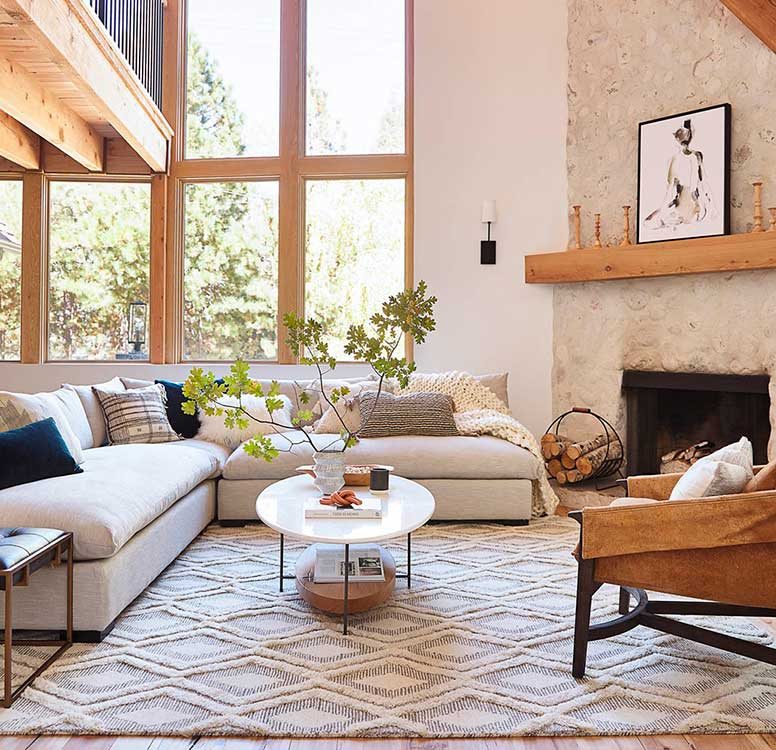 L shaped sectional sofa with corner fireplace.