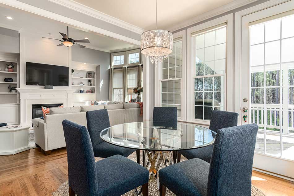 sunny room with rounded table, TV and large sofa