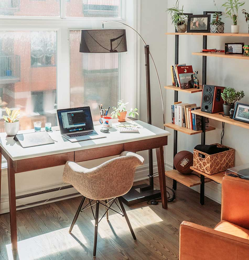 Desk in front of the window with natural light.