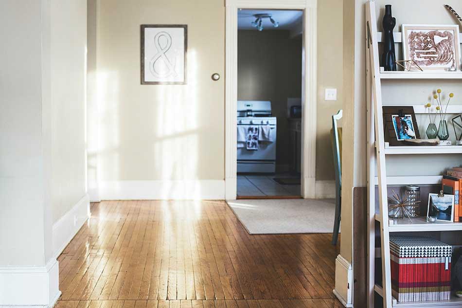 Clutter free, tidy hallway with wooden floor.