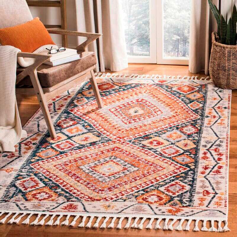 red orange and blue color bohemian rug with tassel in the living room