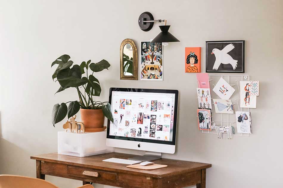 Wall art and pictures behind the desk.