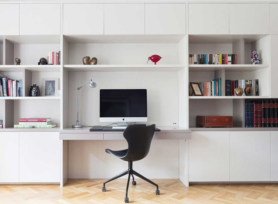 Wall-mounted shelves with desk.