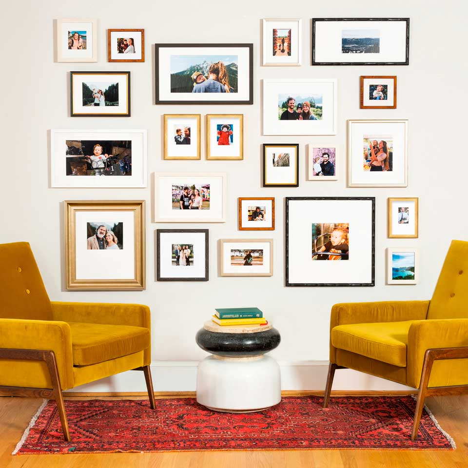 Random wall gallery layout with mixed frames.