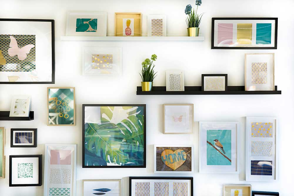Artwork gallery wall sample with mixed frames.