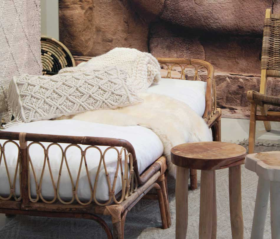 Bohemian rattan sofa and wooden side table