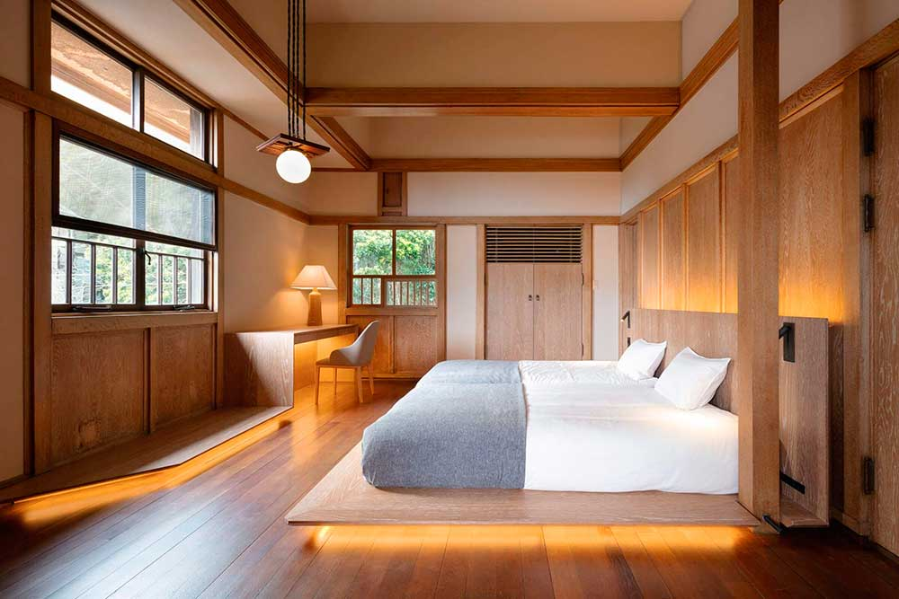 Hotel double room design with wooden platform bed.