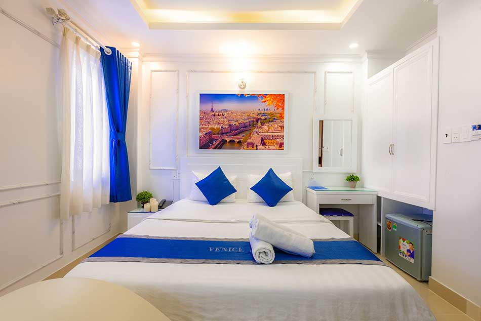 White and blue color double hotel room.