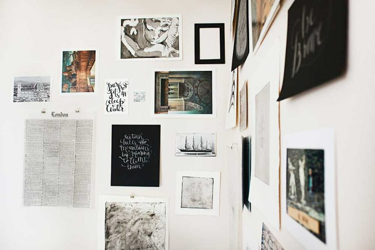 Wall gallery layout on the white wall, corner of the room