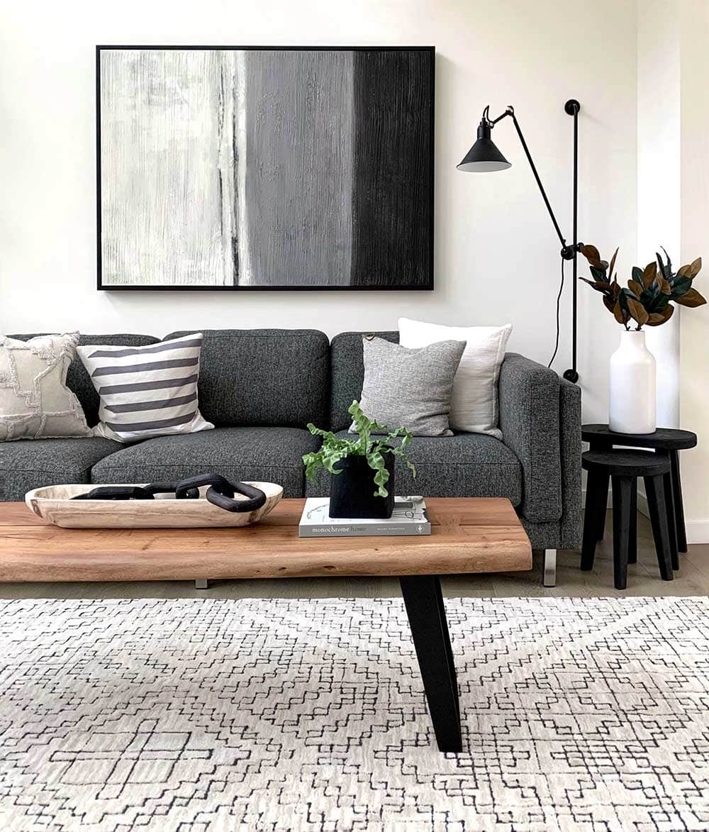 Dark gray sofa and white pattern area rug in the living room.