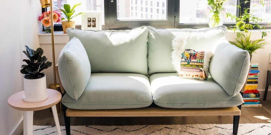 Floyd light color sofa in a small living room