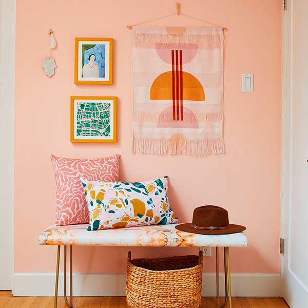 Colorful bench, pillow and handmade wall art.