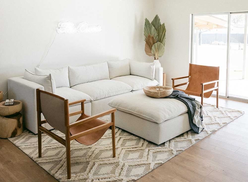 Living room seating arrangement with sofa and two accent chairs.