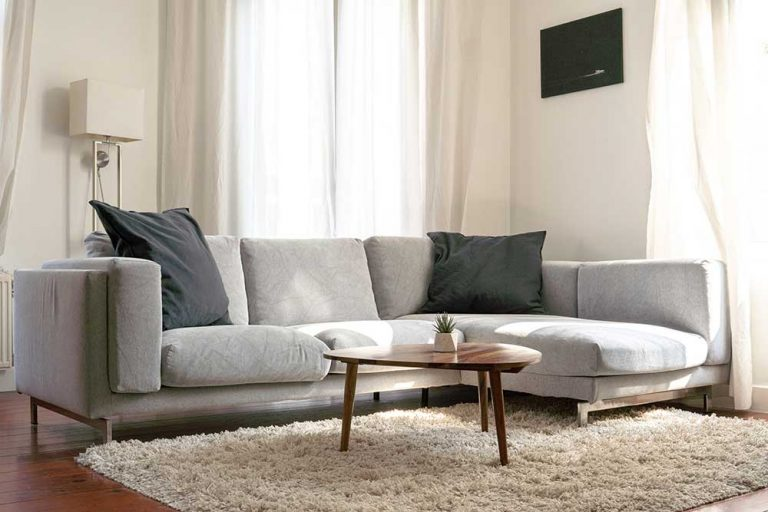 Soft color sectional sofa with coffee table.